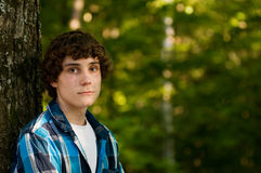 Teen boy outdoors. Handsome teen boy outdoors in summer Royalty Free Stock Photography