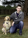Teen Boy outdoors with yellow lab Royalty Free Stock Images