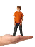 Teen boy in the palm of hand Stock Images
