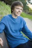 Teen Boy on Park Bench Stock Image