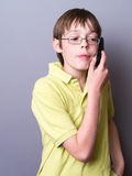 Teen Boy on the Phone Stock Images