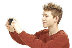 Teen boy photographing with a smartphone Royalty Free Stock Images
