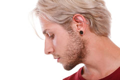 Teen boy with piercing and fashionable hairstyle Royalty Free Stock Photos