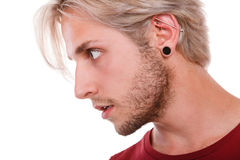 Teen boy with piercing and fashionable hairstyle Royalty Free Stock Images