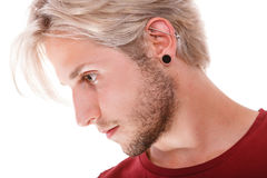Teen boy with piercing and fashionable hairstyle Royalty Free Stock Photography