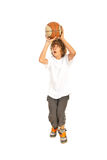 Teen boy playing basketball. Isolated on white background Royalty Free Stock Photo
