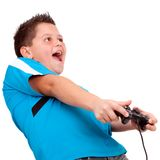 Teen boy playing with console Royalty Free Stock Image