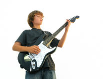 Teen Boy Playing Guitar. Teen boy playing electric guitar isolated over white Stock Images