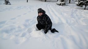 Teen boy playing in the snow stock video footage