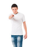 Teen boy pointing to you. Teen boy pointing finger to you. Young caucasian man pointing at camera choosing you, isolated on white background Stock Images