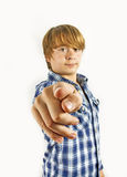 Teen boy pointing at you Stock Images
