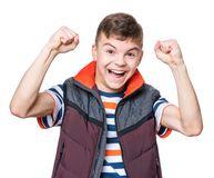 Teen boy portrait. Cheerful handsome teen boy with raising hands. Emotional portrait of caucasian happy cute smiling male child, isolated on white background Stock Images