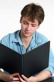 Teen boy reading stock photos