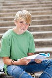 Teen boy reading book Royalty Free Stock Photography
