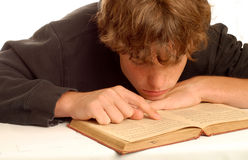 Teen boy reading book Royalty Free Stock Image