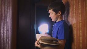 Teen boy reading education book is wall indoor stock video