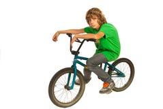 Teen boy resting on bike Stock Image
