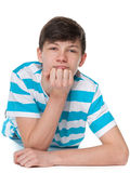 Teen boy is resting on the floor Royalty Free Stock Photography