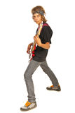 Teen boy rocker with bass guitar. Teen boy rocker playing bass guitar isolated on white background Royalty Free Stock Images