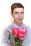Teen Boy with with Roses Royalty Free Stock Photos