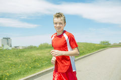 Teen boy run outside in a day light Royalty Free Stock Images