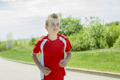 Teen boy run outside in a day light Stock Photo