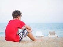Teen boy on beach royalty free stock photography