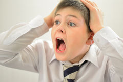 Teen boy screaming holding his hands behind  head Royalty Free Stock Photo