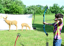 Teen Boy Shooting a Compound Bow Stock Images
