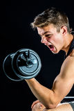 Teen boy shouting at body workout. Royalty Free Stock Image