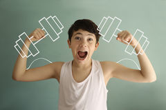 Teen boy show biceps with dumb bells drawn with chalk funny photo Royalty Free Stock Photos