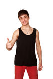 Teen boy showing a thumbs up sign. Royalty Free Stock Photography