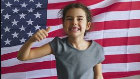 Teen boy shows gesture yes  Independence usa Day American flag Fourth of July. Teen boy  shows gesture yes  Independence usa Day American flag Fourth of July stock video
