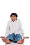 Teen boy sitting on floor Stock Images