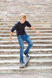 Teen boy skateboarding. On stairs Stock Photography