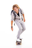 Teen boy skateboarding Stock Images