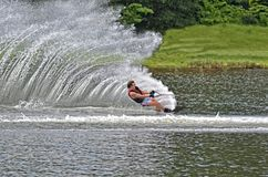 Teen Boy on Slalom Course. Teenage boy on a course during a water ski competition, he cutting to go around a bouy stock images