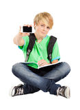 Teen boy with smart phone. Isolated on white Stock Photography