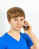 Teen boy with smart phone Stock Image