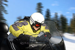 Teen boy on snowmobile royalty free stock images