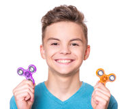 Teen boy with spinner on white Royalty Free Stock Image