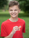 Teen boy with spinner Stock Image