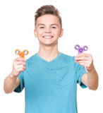 Teen boy with spinner Royalty Free Stock Photo