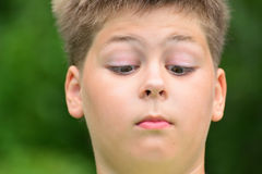 Teen boy squinted down to his nose Royalty Free Stock Photography