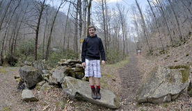 Boy at the Appalachian Trail. A teen boy standing at the Appalachain Trail ready for a hike. Fish eye lens royalty free stock images