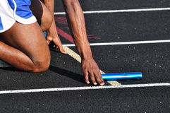 Teen Boy in the Starting Blocks. At a Track Meet Stock Photo