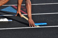 Teen Boy in the Starting Blocks. For a Relay Race Royalty Free Stock Photos