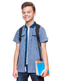 Teen boy student. Portrait of young student with school bag and books. Teenager smiling and looking at camera. Happy teen boy, isolated on white background Royalty Free Stock Photos