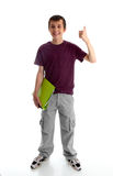 Teen boy or student with thumbs up. A happy male teen dressed in cargoes and maroon marle t-shirt, is carrying a lime green folder in one hand and showing thumbs Stock Photos