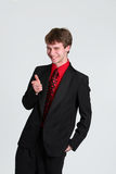 Teen boy in suit pointing Royalty Free Stock Photography